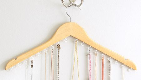 Hook and eye jewellery holder with a hanger